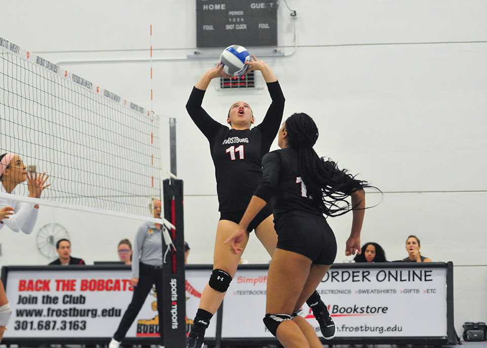 Edwyna lainez jump setting a volleyball for teammate