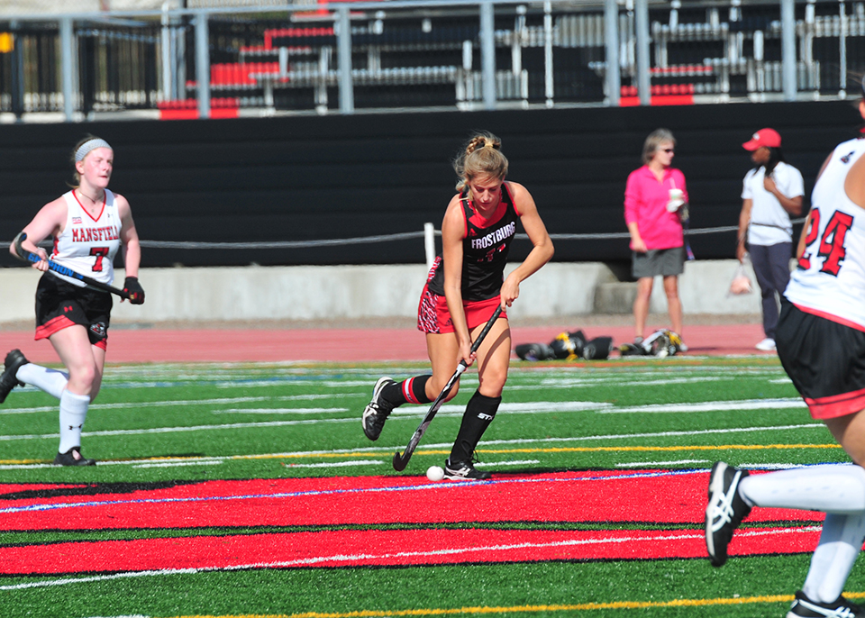 Gabby Rachuba playing field hockey