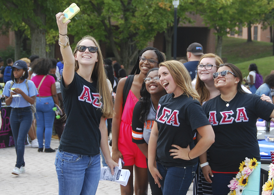 Sorority sisters taking a group selfie
