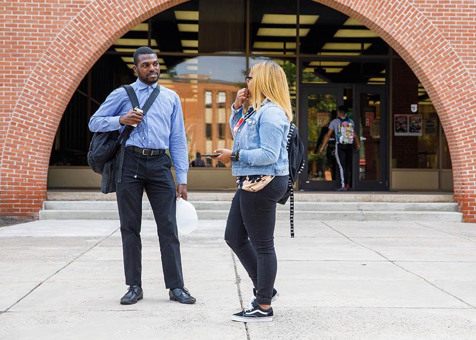 business casual students talking in front of Ort library