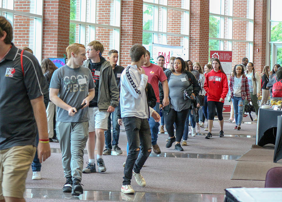 large group of potential students walking through lobby of Performing Arts Center