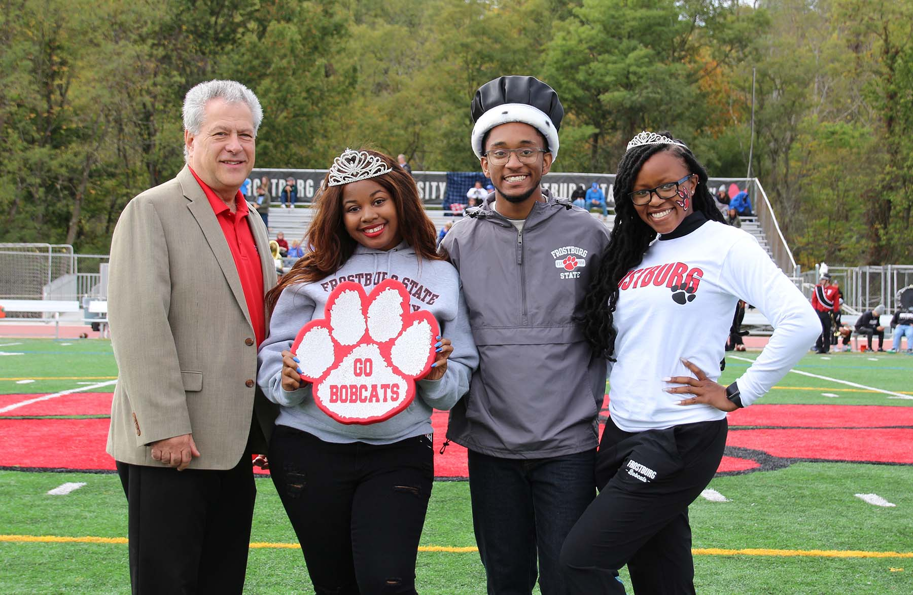 President Nowaczyk with homecoming queen, king, princess