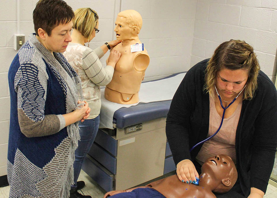 Nurses work on simulation mannequins