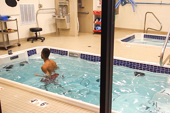 patient using rehab pool