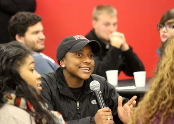 female student talking into microphone