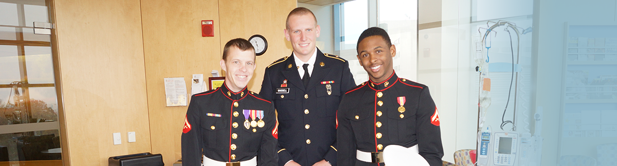 photo of three veterans in dress uniforms