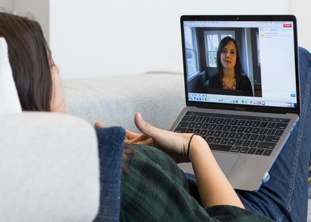 female talking to counselor online